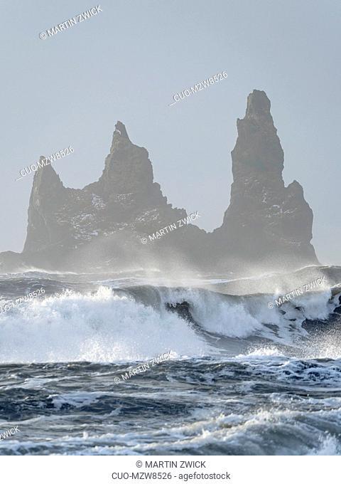 The coast of the north atlantic near Vik y Myrdal during winter.The sea stacks Reynisdrangar. Europe, Northern Europe, Scandinavia, Iceland, February