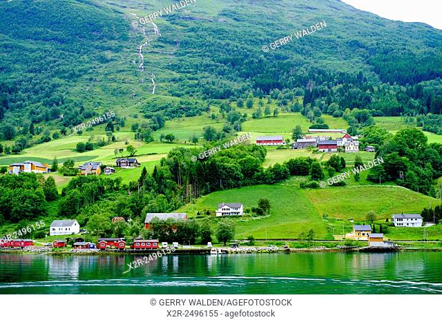Lakeside Community, Olden, Norway showing lakeside cabins, farm buidings and woodland