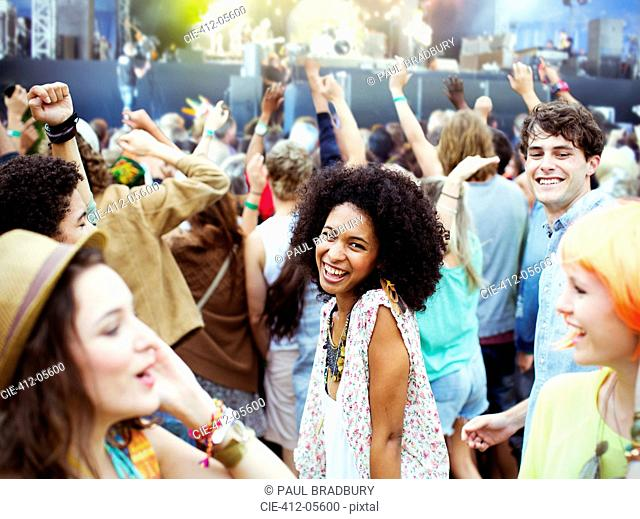 Fans dancing and cheering at music festival