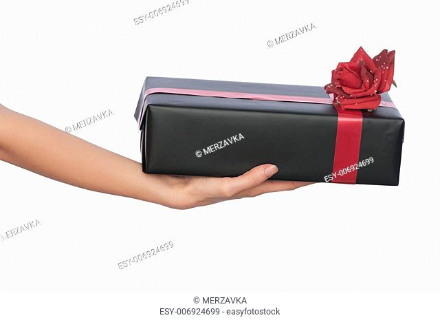 woman giving a black box with red ribbon as a gift