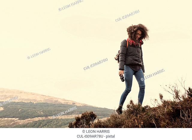 Woman hiking, looking down