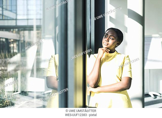 Businesswoman looking out of the window in office