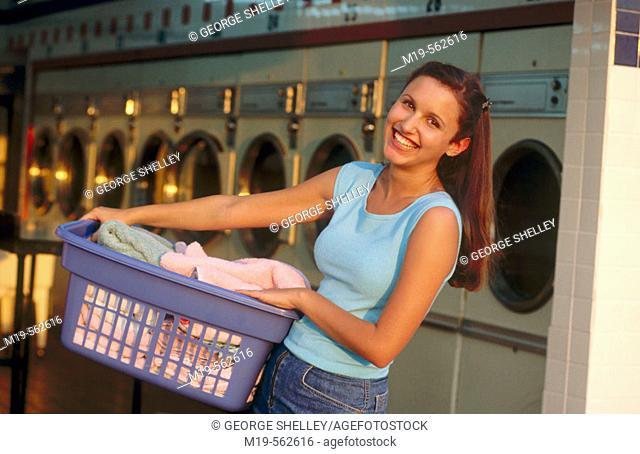 girl at a laundromat
