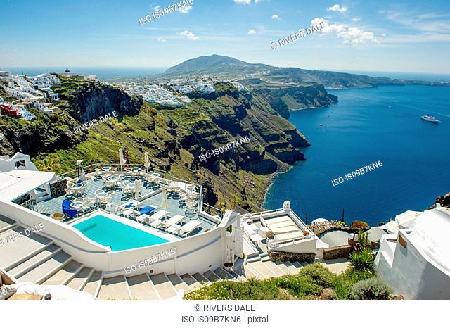 View of hotel's pool and sea, Oia, Santorini, Greece