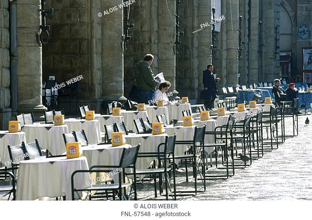 Chairs and tables at a sidewalk cafe, Piazza Maggiore, Bologna, Emilia-Romagna, Italy