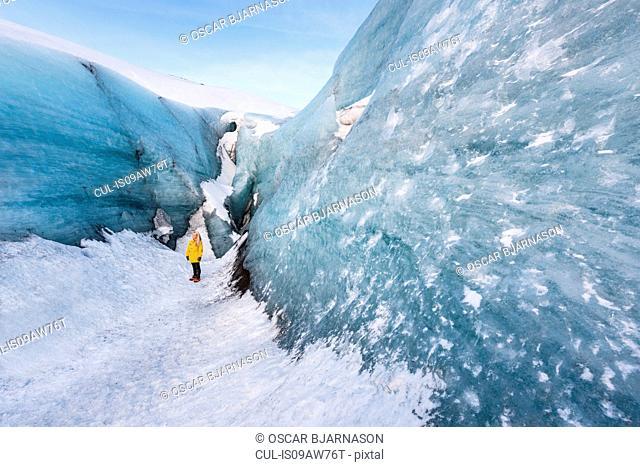 Woman exploring glacier, Solheimajokull, Iceland