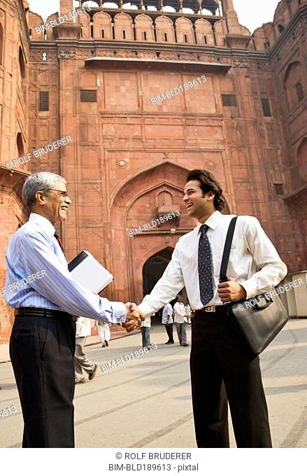 Indian businessman shaking hands at the Red Fort