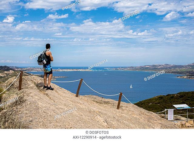 Man enjoying the panoramic view from Capo d'Orso; Palau, Sardinia, Italy