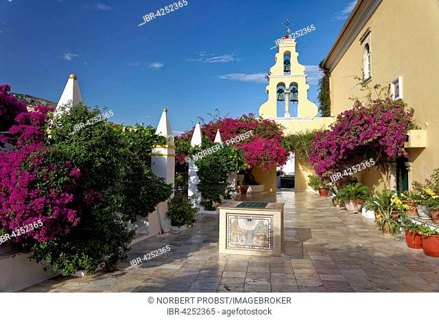 Courtyard with fountain, clock tower and bougainvillea, monastery of Panagia Theotokos tis Paleokastritsas or Panagia Theotokos, Paleokastritsa, Corfu