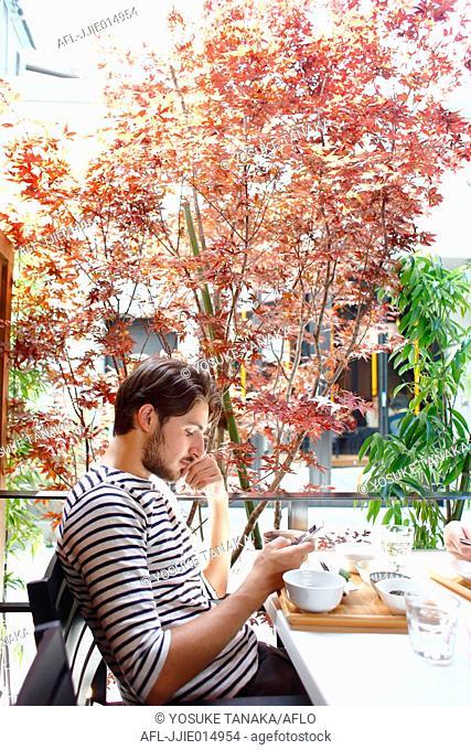 Caucasian man enjoying food in Tokyo, Japan