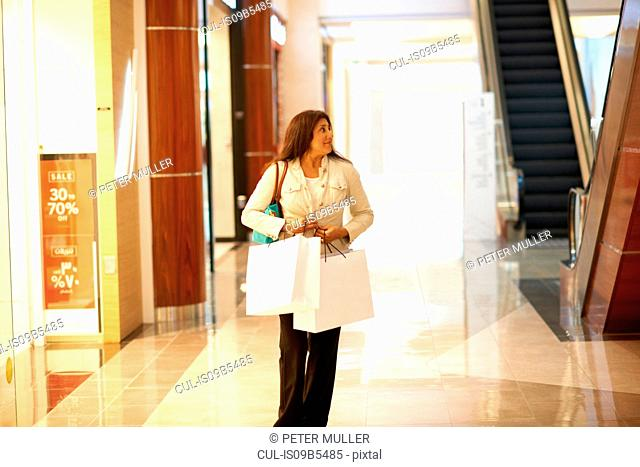 Arab woman with shopping bags Stock Photos and Images | age fotostock