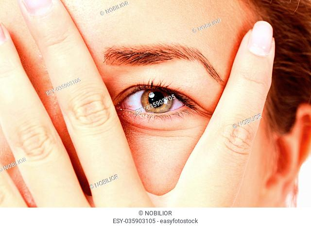 girl looking between her fingers