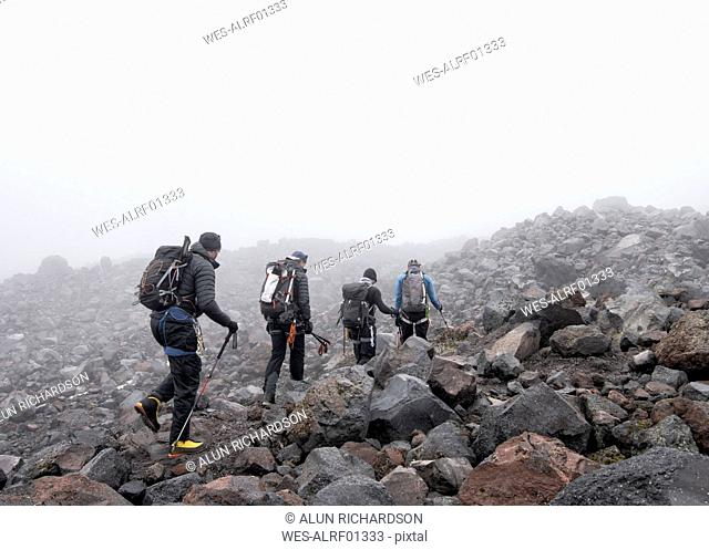 Russia, Upper Baksan Valley, Caucasus, Mountaineers setting off at North camp