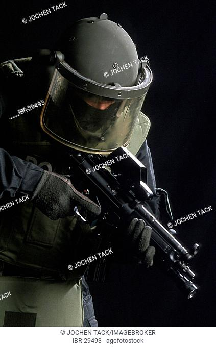 DEU, Germany: Police SWAT Team, for arresting armed and dangerous criminals. They are specialists for rescuing hostages. They have special weapons and equipment