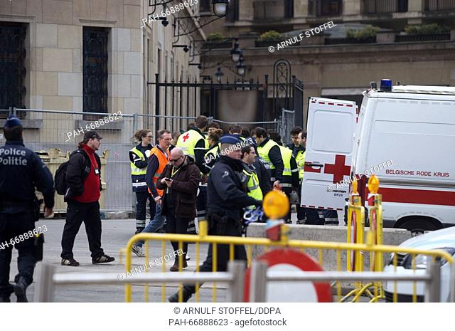 Rescue services work in the area surrounding Maelbeek metro station inBrussels, Belgium, 22 March 2016. At least 26 people have been killed on the same day in...