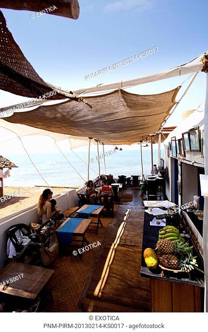 Tourists in a restaurant, Om Made Cafe, Anjuna, North Goa, Goa, India