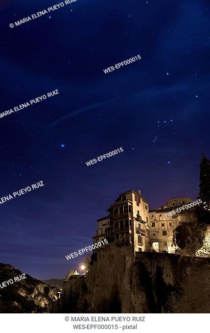 Spain, Castile-La Mancha, Cuenca, Orion constellation over The Casas Colgadas or Hanging Houses