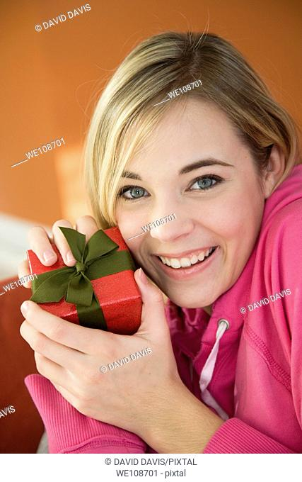 Young woman excited after recieving a special gift