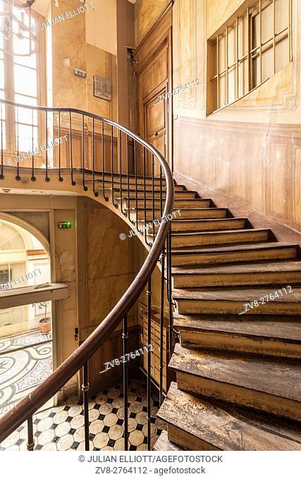 A spiral staircase in Galerie Vivienne, Paris