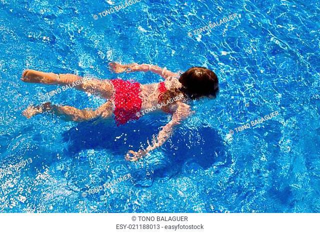 bikini kid girl swimming on blue tiles pool