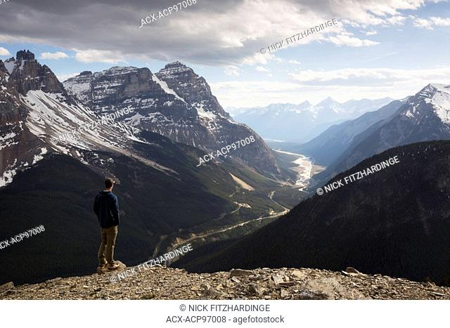 Male hiker looking down at the kicking Horse Valley from Paget Peak, Yoho National Park, British Columbia, Canada