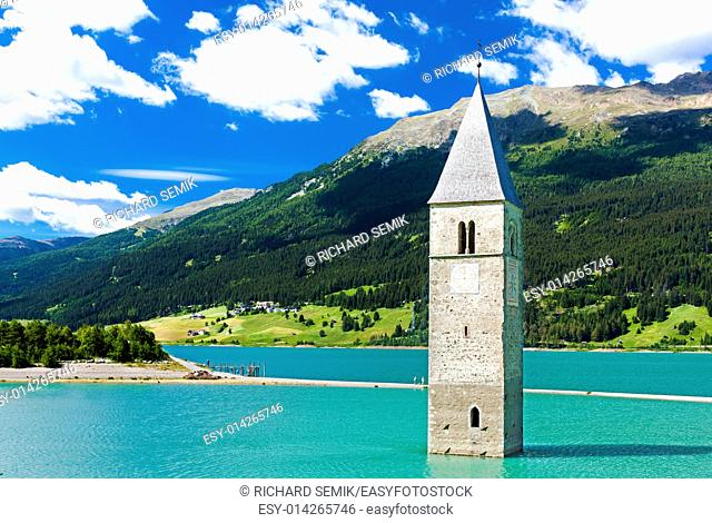 tower of sunken church in Resia lake, South Tyrol, Italy