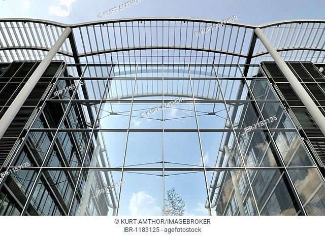 Glass façade of a modern high-rise office complex, skyscraper Uptown Munich, second-tallest building in Munich, Georg-Brauchle-Ring, Munich, Bavaria, Germany