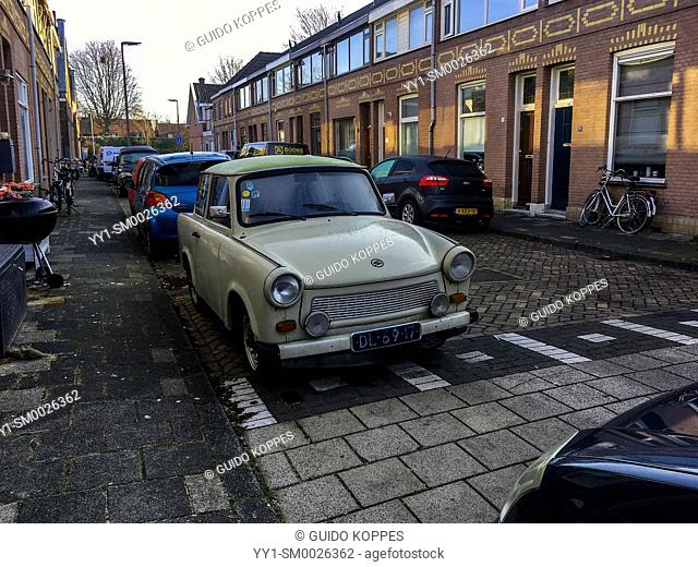 Dordrecht, Netherlands. A 1971 build East-German Trabant parked in a residential street, just prior to a daytrip. Driving vintage old timers is, for some people