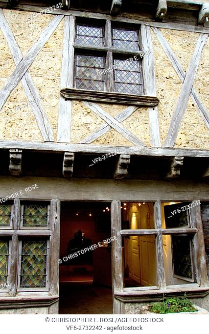 Europe, France, Quercy, Lot, 46, St Cirq Lapopie, old front door and mullioned window of a stone built cottage