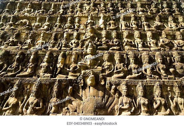 Ornate bas-reliefs at the Terrace of the Leper King, in the premises of Angkor Thom, Cambodia