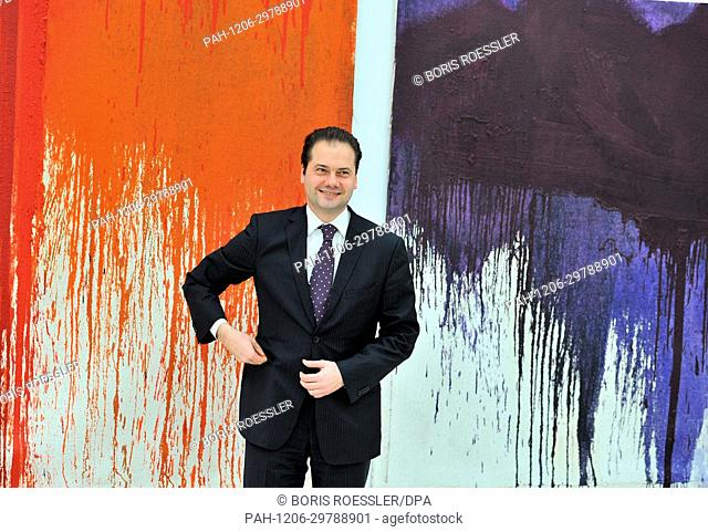 "Max Hollein, director of the Staedel, stands in front of """"Painting Action - Red"""" and """"Painting Action - Violet"""" by Hermann Nitsch in the newly opened..."