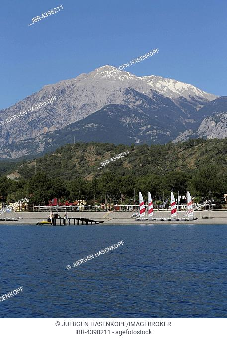 Empty beach, Çamyuva resort with Mt Tahtali, Turkish Riviera, Antalya Province, Turkey