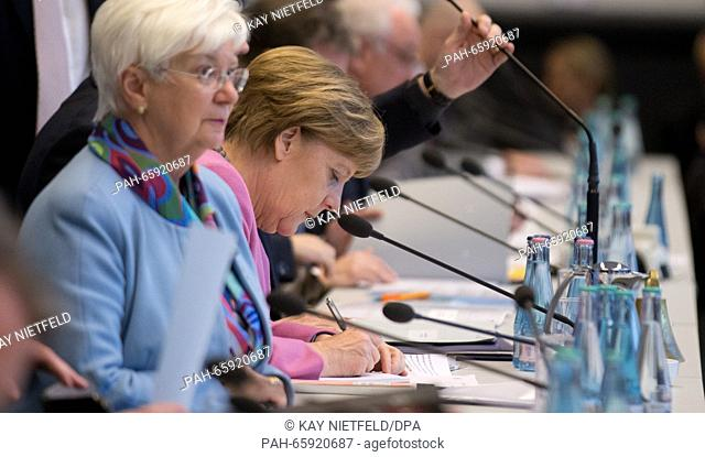 German Chancellor Angela Merkel (r, CDU), and chairwoman of the Bundestag group of CSU parliamentarians, Gerda Hasselfeldt
