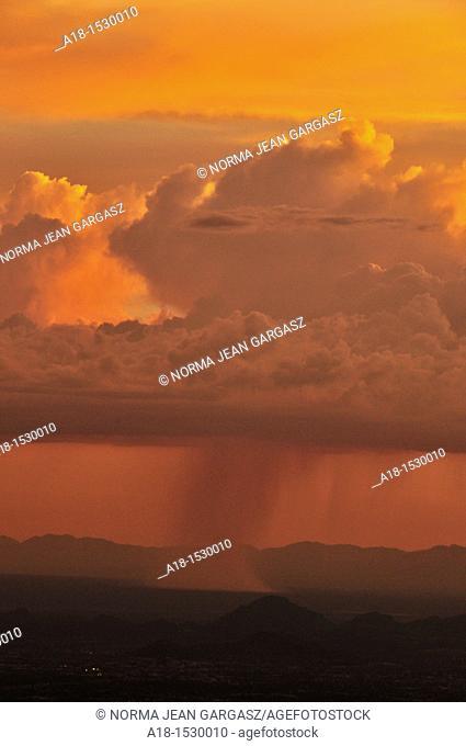 Sunset during monsoon is seen from Windy Point, Mount Lemmon, Coronado National Forest, Sonoran Desert, a Sky Island near Tucson, Arizona, USA