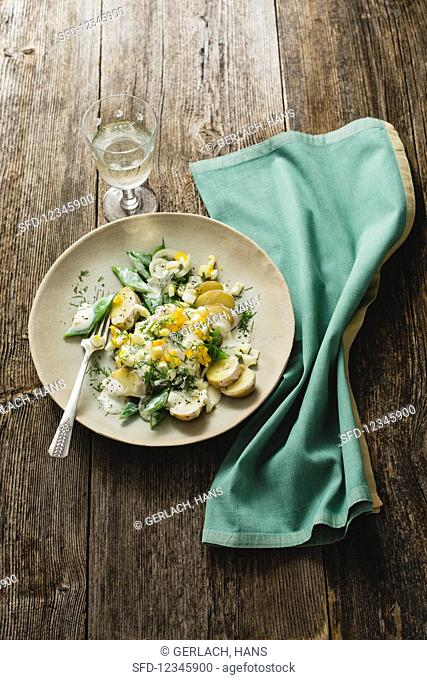 Green bean, egg, and potato salad with a sour cream and dill dressing