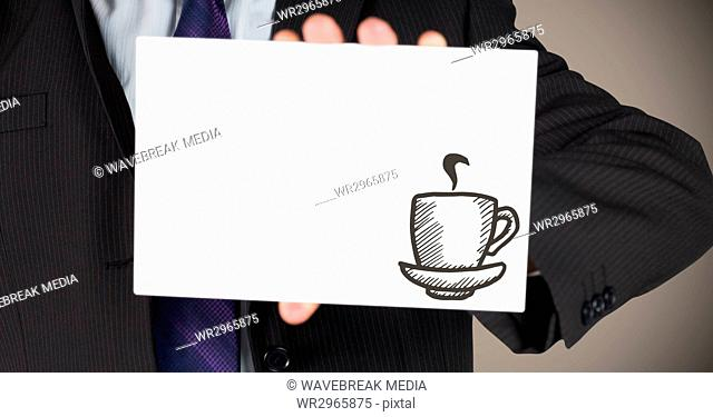 Business man mid section with card showing brown coffee doodle against brown background