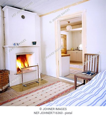 A bedroom with an open fireplace, Sweden