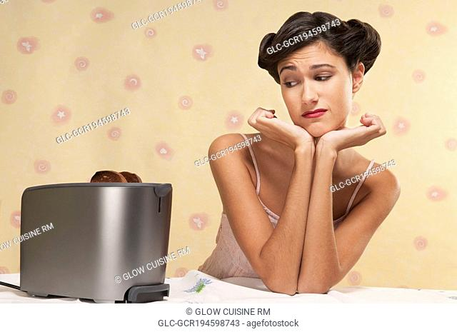 Woman frowning at burnt toast