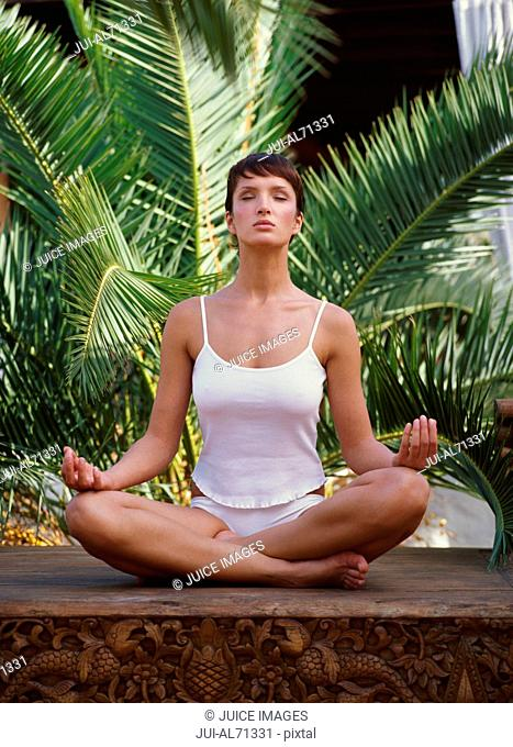Portrait of a young woman doing yoga
