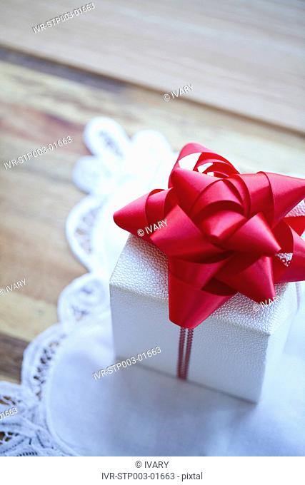 Wrapped Christmas Gift Box With Red Ribbon