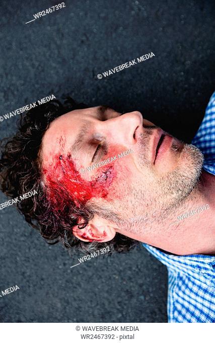 Injured man lying on the ground