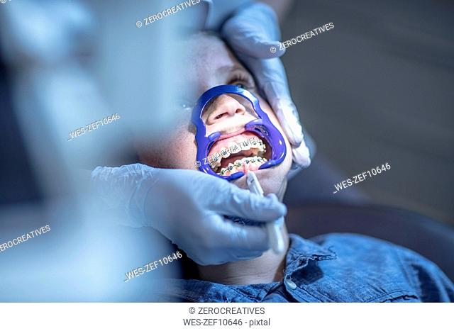 Boy in dental surgery receiving orthodontic treatment