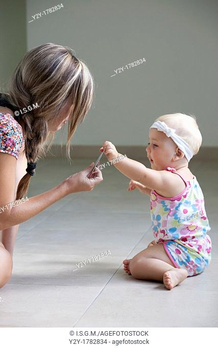 Mother showing a credit card to her daughter