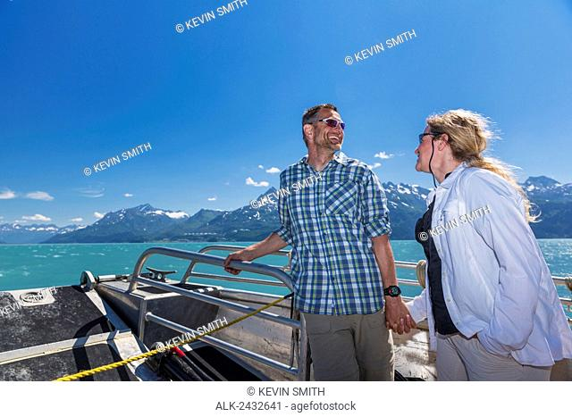 Couple enjoy the scenery while on a water taxi in Prince William Sound, Southcentral Alaska
