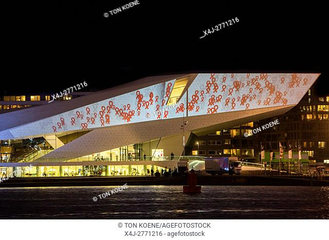Red ribbon projection on EYE museum in amsterdam on world aids day 2016