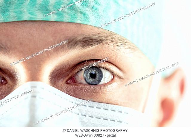 Surgeon with blue eyes, close-up