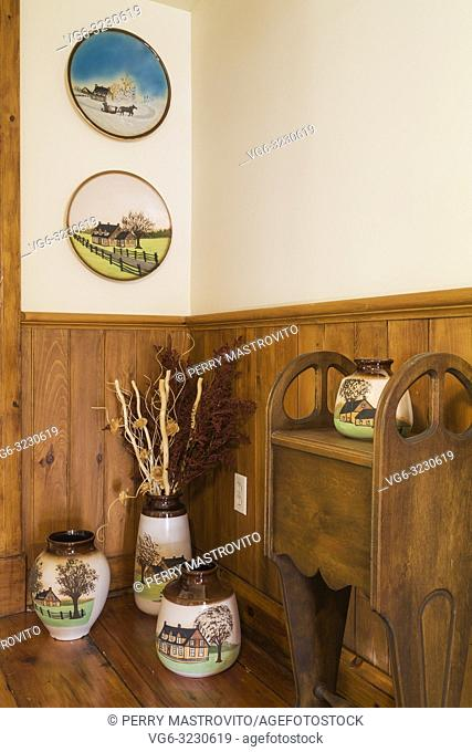 Painted and glazed ceramic pots displayed on upstairs hallway inside an old 1892 Canadiana cottage style home