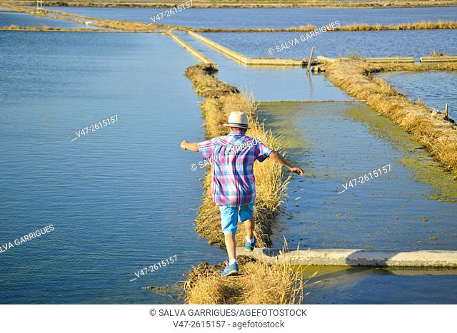 Happy boy jumping ditches rice fields, Albufera in Valencia, Spain, Europe