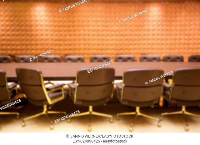 Background blur of stylish empty conference room ready for a meeting