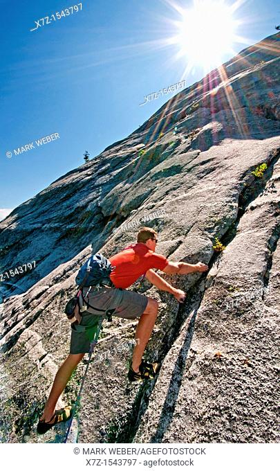Rock climbing a route called Memorial which is rated 5,8 and located on Slick Rock near the city of McCall in the Salmon River Mountains of central Idaho